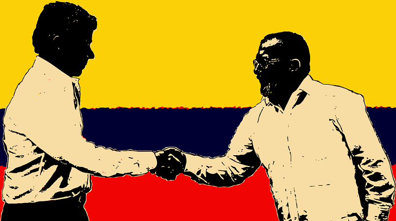 El presidente Juan Manuel Santos y el líder Timoleón Jiménez Tirofijo firman la paz | Imagen: Guillermo Tell Aveledo